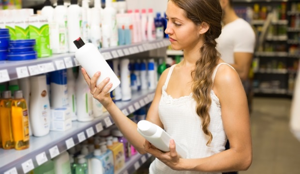 woman choosing sulfate free shampoo