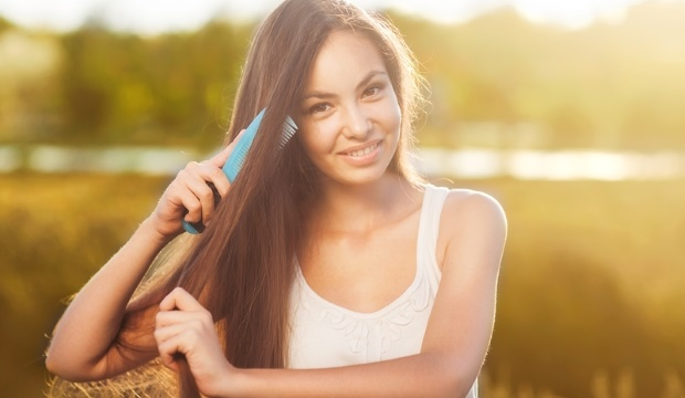 young girl combing hair